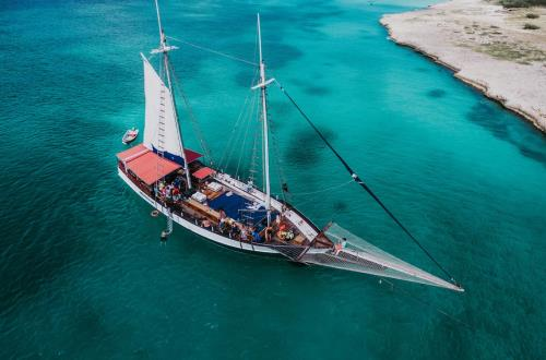 a group of guests spend time together on a private schooner