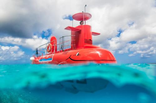 Red submarine half submerged