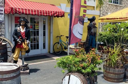 statues of pirates stand outside of a building