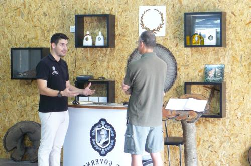 a guide explains the tastings to a guest
