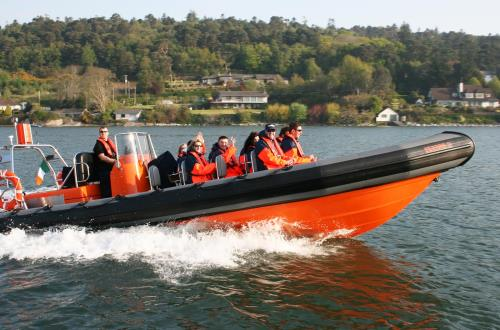 tour guests enjoy sightseeing on a motor boat