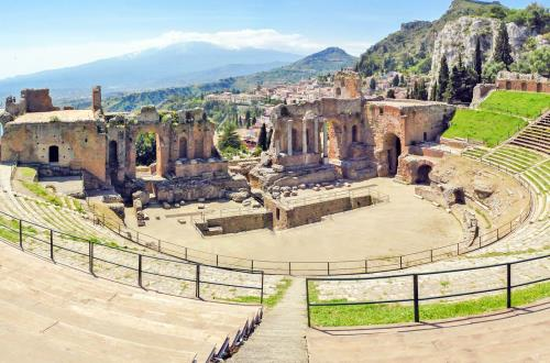 landscape view of a roman theater with a beautiful view of mountainous terrain in the background