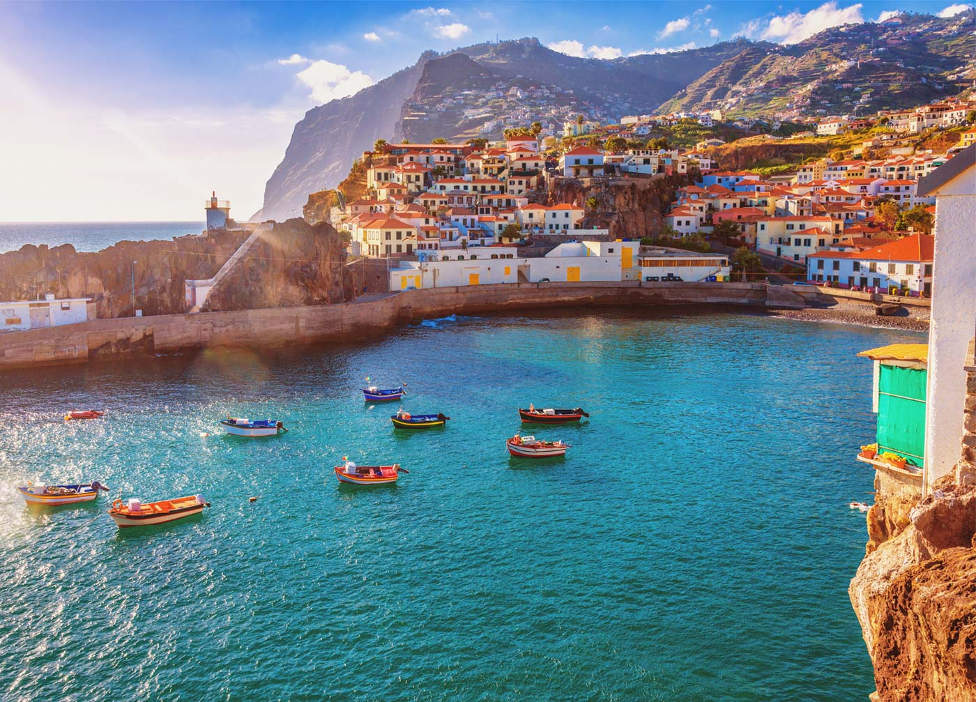 beautiful view of clear blue water near the town in funchal portugal