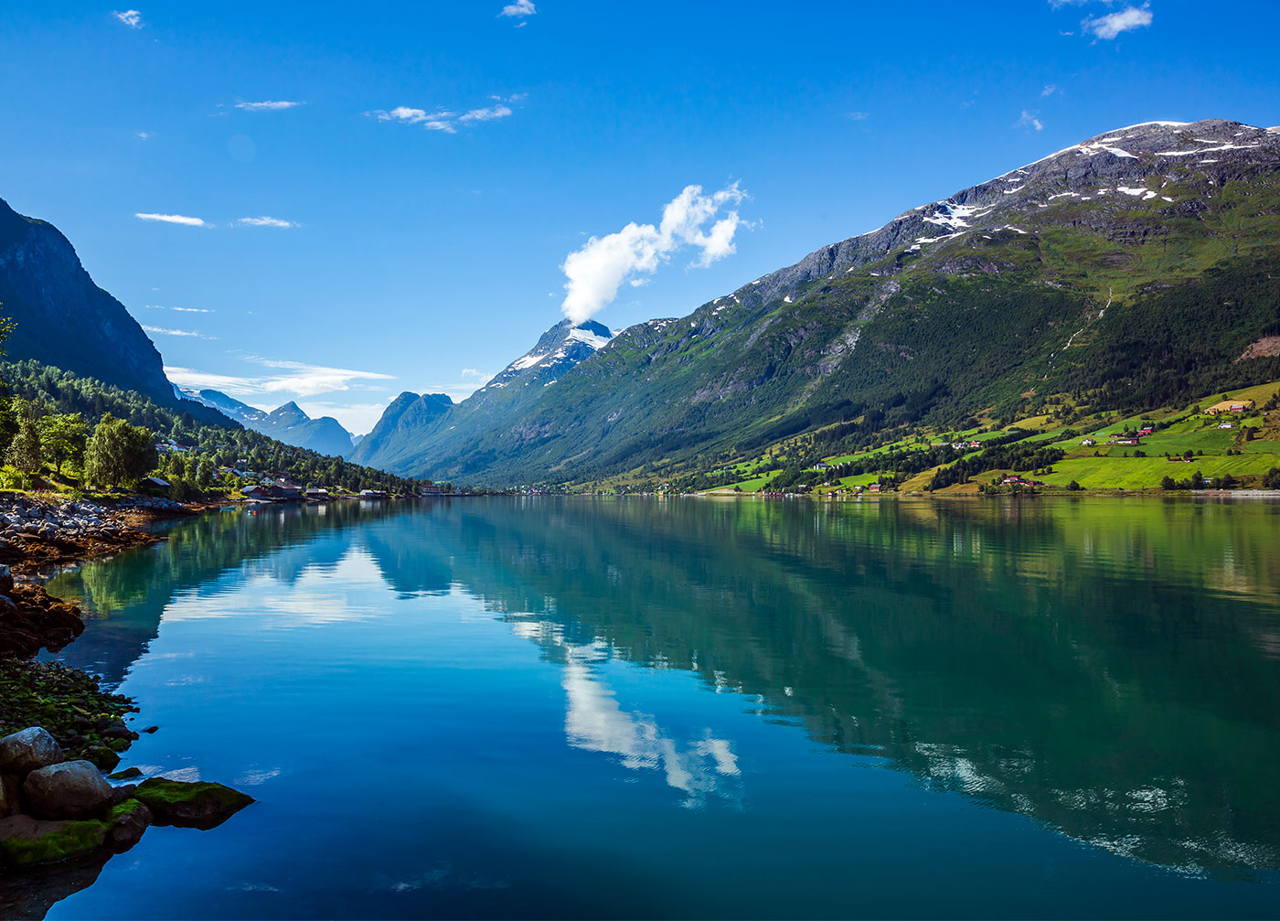 gorgeous view of flo mountain and lake on a clear day in hellesylt norway