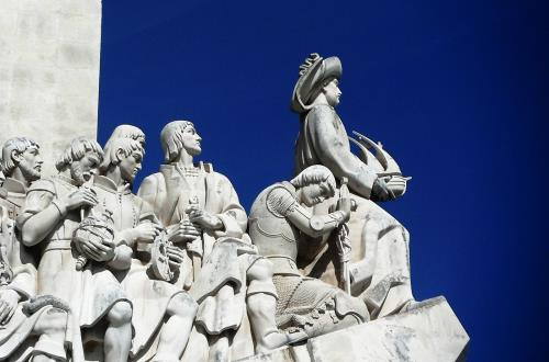 close up of figures at top of Monument of Discoveries