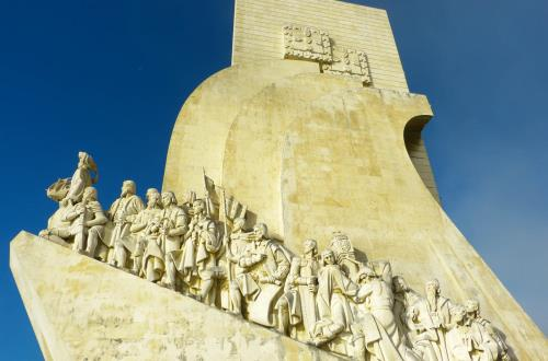 close up view of monument of discoveries carved from stoen adn situated on seawall