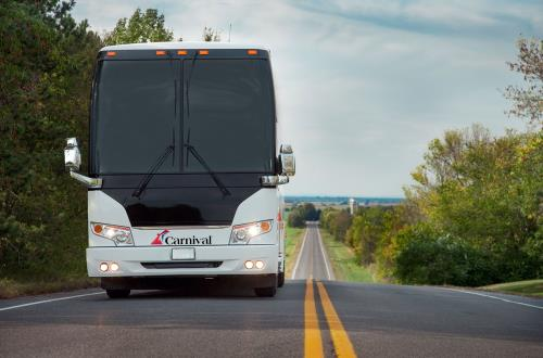 image of front of large white transportation bus