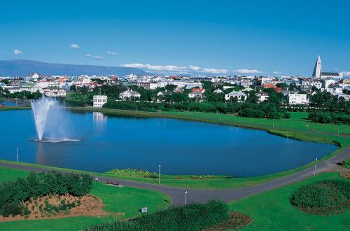 a vibrant sunny day at the local pond in the city of Reykjavik