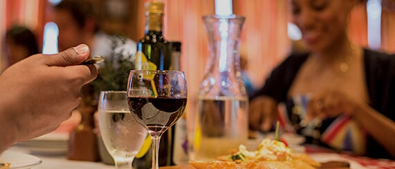 Dining - couple enjoying entrees and wine at cucina del capitano
