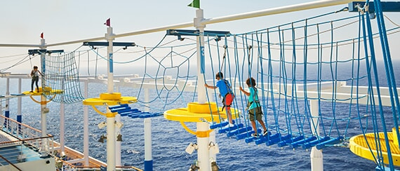 guests enjoying the ropes course aboard a carnival cruise ship