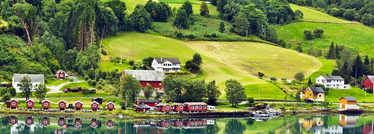 village along green hills in olden, norway