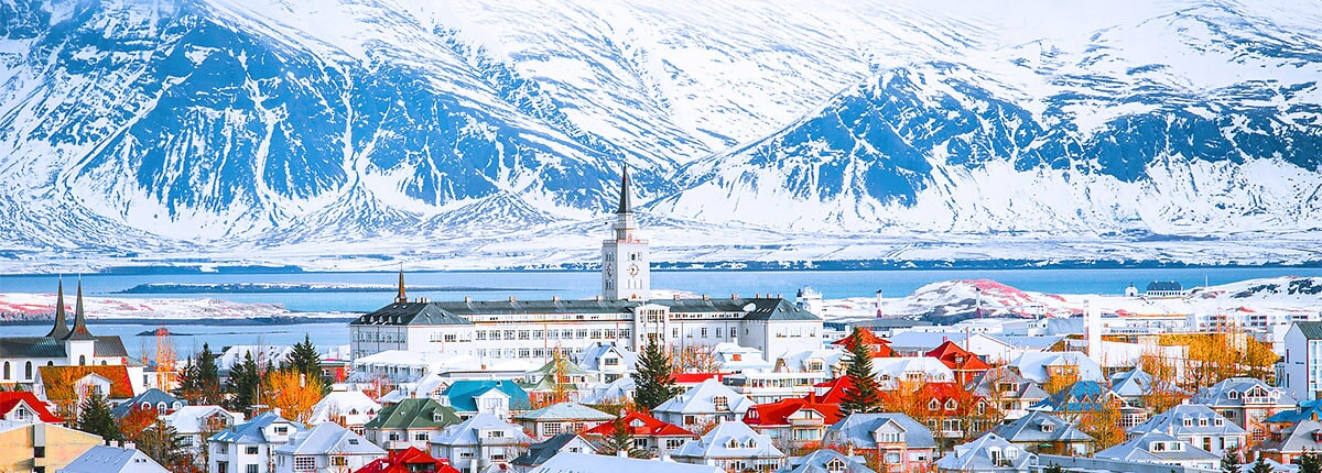 city of reykjavik with the mountains in the background