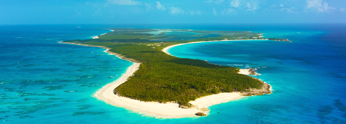 aerial view of half moon cay island shows beautiul blue water surrounding the island