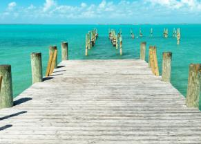 beautiful view of the blue ocean water seen from a dock in princes cays, the bahamas